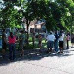 Residents interacting with the Gallery of Images at a Charles Ave Friendly Streets block party, 2011