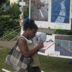 A Charles Ave block party attendee filling out a survey